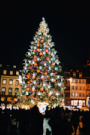 central square: Defocused view of Christmas Tree in central square of Strasbourg, France, Alsace during the most famous Christmas Market