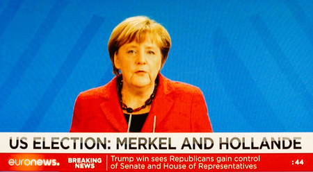 skepticism: PARIS, FRANCe - CIRCA 2016: Watching on TV German Chancellor Angela Merkel after USA election results  as Donald Trump is the 45th President of United States of America.