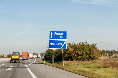 Entrance to the Hungary sign while leaving Austrian highway autobahn