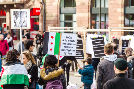 al assad: STRASBOURG, FRANCE MAR 19, 2016: No to Russian weapons being sell to Syrian regime - placard at the anti Bashar Al Assad demonstration