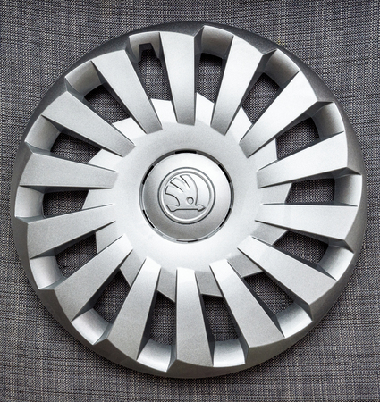 PARIS, FRANCE - DEC 18, 2016: Modern hubcap hub covers for the winter tyres made by Skoda Auto for Skoda Superb, Skoda OCtavia and Skoda Roomster  - online internet shopping