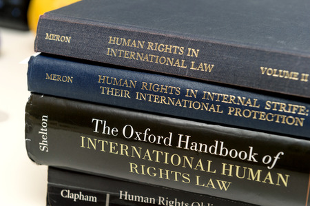 obligations: PARIS, FRANCE - NOV 27, 2016: Stack of diverse Human Rights law books preparation for examination exam pass, mb and phd thesis Editorial