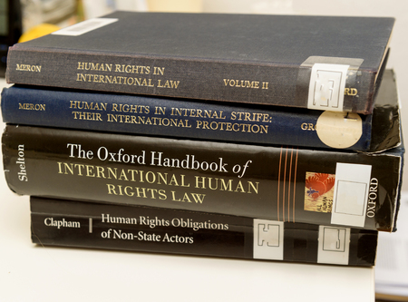 obligations: PARIS, FRANCE - NOV 27, 2016: Diverse Human Rights law books preparation for examination exam pass, mb and phd thesis