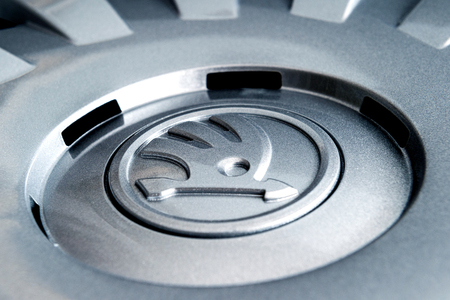 hubcaps: PARIS, FRANCE - DEC 18, 2016: Detail of modern hubcap hub covers for the winter tyres made by Skoda Auto for Skoda Superb, Skoda OCtavia and Skoda Roomster - online internet shopping
