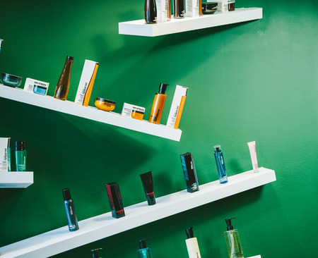 STRASBOURG, FRANCE - AUG 30, 2014: Shu Uemura cosmetics arranged in modern eclectic style in boutique interior. Shu Uemura was a Japanese make-up artist and founder of the Shu Uemura international cosmetics Editorial