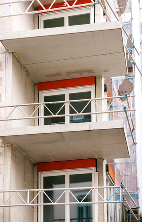Modern apartment construction with new PVC windows and protection fence for the workers Stock Photo