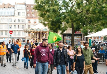 guerilla: STRASBOURG, FRANCE - SEP 12, 2015: Large group of Kurdish community wave flags and banners of convicted Kurdistan Workers Party (PKK) leader Abdullah Ocalan during a demonstration calling for Ocalans release in Strasbourg