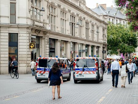 guerilla: STRASBOURG, FRANCE - SEP 12, 2015: Police van surveillance of large group of Kurdish community wave flags and banners of convicted Kurdistan Workers Party (PKK) leader Abdullah Ocalan during a demonstration calling for Ocalans release in Strasbourg