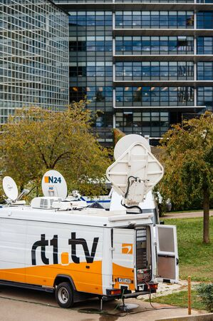 STRASBOURG, FRANCE - OCT 7, 2015: Tv Televison Truck with multiple Satellite parabolic antennas and fiber optic cables going inside reporting live the official French president visit to the European PArliament in Strasbourg, France Editorial