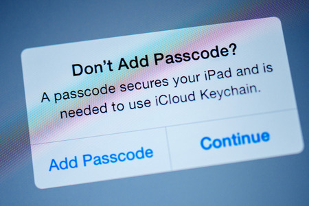 passcode: PARIS, FRANCE - SEPTEMBER 18, 2014: Dont add passcode, a passcode secures your ipad and needed to use iCloud keychain - message on the computer tablet screen during iPad configuration