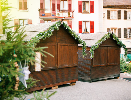 Empty Christmas Market in Thann village - in the place of the St. Thiebault Collegiate - Eastern France, Aslace