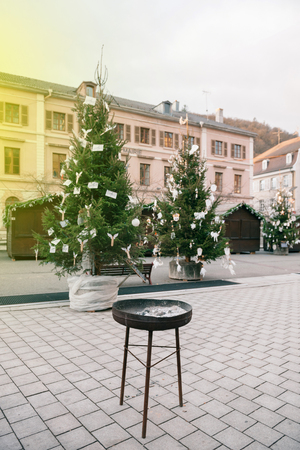THANN, FRANCE - DEC 12, 2015: Empty Christmas Market in Thann village - in the place of the St. Thiebault Collegiate - Eastern France, Aslace Editorial