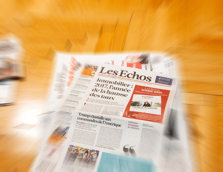 above 21: PARIS, FRANCE - JAN 21, 2017: Les Echos magazine above major international newspaper journalism with headline of Donald Trump inauguration as the 45th President of the United States in Washington, D.C Editorial