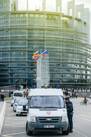 STRASBOURG, FRANCE - OCT 7, 2015: Police officers surveilling the main entrance of the European PArliament during the official  visit of Francois Hollande French President to Strasbourg, European Parliament and Council of Europe Editorial