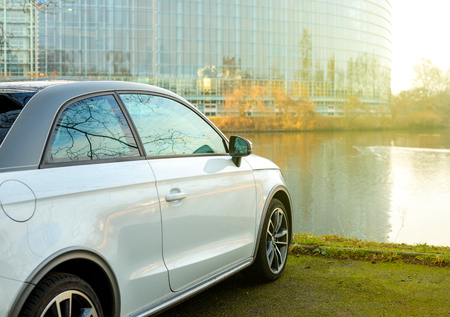 typ: STRASBOURG, FRANCE - FEB 2, 2017: Audi A1 car parked in front of the European Parliament building in Strasbourg, Alsace France Editorial