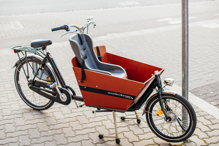 STRASBOURG, FRANCE - FEB 13, 2017: Beautiful children cargo bike parked on the street. The cargobike made by Amsterdamer  is a transport bicycle thats user friendly and ensures absolute cycling pleasure, has a low instep and the centre of gravity is clos