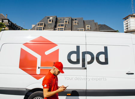 STRASBOURG; FRANCE - JUN 24; 2016: White parcel DPD parcel delivery van with driver worker delivering parcel in French city of Strasbourg. DPD or Dynamic Parcel Distribution is an international parcel delivery company owned by GeoPost.