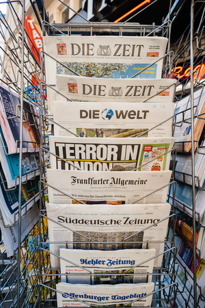 law breaking: PARIS, FRANCE - MAR 23, 2017: German newspapers on stand of a press kiosk featuring headlines following the terrorist incident in London at the Westminster Bridge
