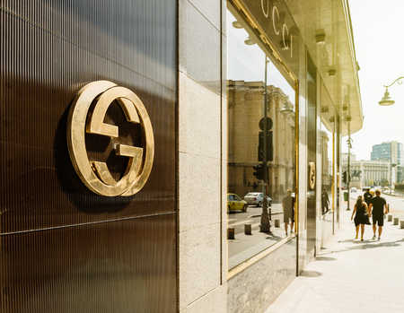 BUCHAREST, FRANCE - APR 1, 2016: Gucci sign logo on fashion store official boutique flagship store in Bucharest. Gucci is a luxury brand known for modern, Italian-crafted leather goods, apparel & accessories for men & women Editorial