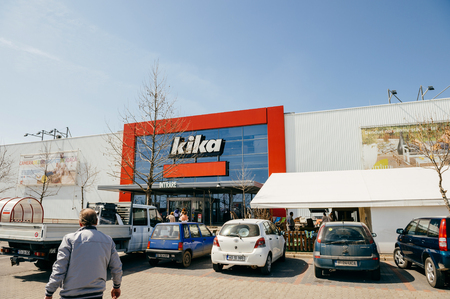 headquartered: BUCHAREST, ROMANIA - APR 1, 2016: Man walking toward Kika entrance facade of the furniture and household store. Kika is an international chain of furniture stores, headquartered in Austria. It has 70 stores, most of them in Europe. Editorial