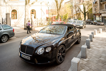 BUCHAREST, ROMANIA - APR 1, 2016: Luxury Bentley Continental GT Convertible Cabriolet parked on the street of the Eastern Capital city of Bucharest, Romania 에디토리얼