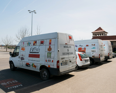 furniture store: BUCHAREST, ROMANIA - APR 1, 2016: Furniture delivery vans in a row with KIKA store advertising and logotype. Kika is an international chain of furniture stores, headquartered in Austria Editorial