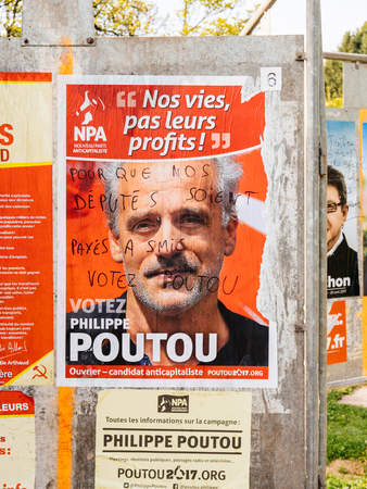 STRASBOURG, FRANCE - APR 12, 2017: Official campaign posters of Philippe Poutou, political party leader of Nouveau Parti anticapitaliste (NPA), ones of the eleven candidates running in the 2017 French presidential election Editorial