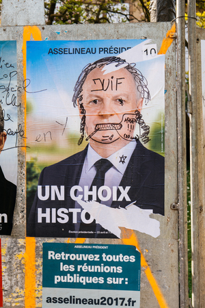 STRASBOURG, FRANCE - APR 12, 2017: Official campaign posters of Francois Asselineau, political party leader of Union populaire republicaine (UPR), ones of the eleven candidates running in the 2017 French presidential election
