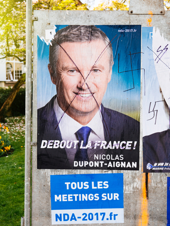 STRASBOURG, FRANCE - APR 12, 2017: Official campaign posters of Nicolas Dupont-Aignan, political party leader of Debout la France (DLF), ones of the eleven candidates running in the 2017 French presidential election Editorial