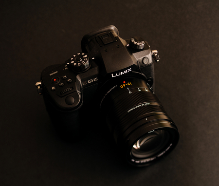 PARIS, FRANCE - APR 9, 2017: view detail of the Panasonic Lumix DMC-GH5 - and Leica Vario-Elmarit 12-60 Micro Four Thirds System digital still and video camera with 4K 10 bit Video recording internal capability.