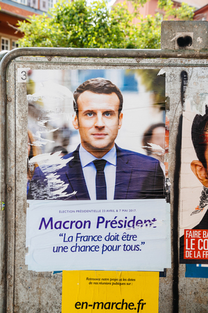 emmanuel: STRASBOURG, FRANCE - APR 23, 2017: Official campaign posters of Emmanuel Macron, political party leader of En marche ! (EM !) on the first round of 2017 French presidential election Editorial