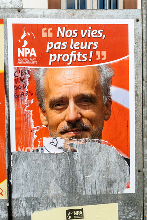 agitation: STRASBOURG, FRANCE - APR 23, 2017: Official campaign posters of Philippe Poutou, political party leader of Nouveau Parti anticapitaliste (NPA)