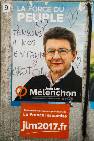 STRASBOURG, FRANCE - APR 26, 2017: Official campaign posters of Jean-Luc Melenchon, political party leader of La France insoumise vandalized on the first round of 2017 French presidential election