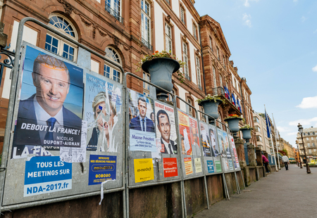 STRASBOURG, FRANCE - APR 23, 2017: French presidential posters for the upcoming presidential election in France, in front of the City Hall building in Strasbourg Editorial