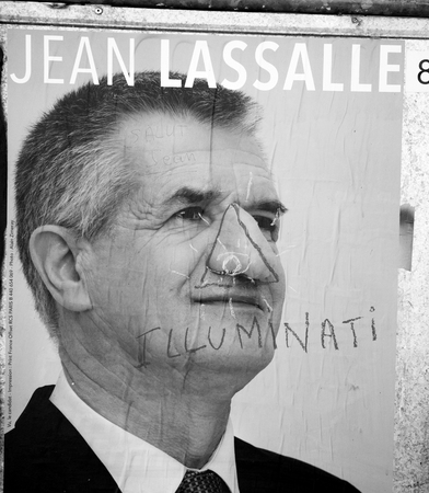 agitation: STRASBOURG, FRANCE - APR 26, 2017: Official campaign posters of Jean Lassalle political party leader of Resistons, vandalized on the first round of 2017 French presidential election