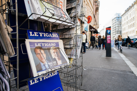 emmanuel: PARIS, FRANCE - APRIL 24: press kiosk at French newspaper Le Figaro with pictures of French Presidential election candidates, Emmanuel Macron, Marine Le Pen a day after first round of French Presidential election on April 23, 2017