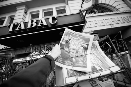 emmanuel: PARIS, FRANCE - APRIL 24: Man buy looks at press kiosk at French newspaper Aujordhui with pictures of French Presidential election candidates, Emmanuel Macron, a day after first round of French Presidential election on April 23, 2017