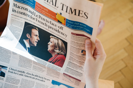 emmanuel: PARIS, FRANCE - APR 24, 2017: Emmanuel Macron and MArine Le Pen on Financial Times newspaper cover - woman reading the newspaper  a day after the first round of the French Presidential election on April 24, 2017 Editorial