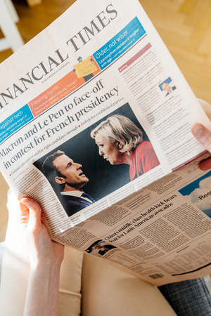 french ethnicity: PARIS, FRANCE - APR 24, 2017: POV personal perspective on Financial Times newspaper cover - woman reading the French newspaper a day after the first round of the French Presidential election on April 24, 2017 Editorial