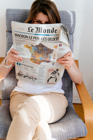 french ethnicity: PARIS, FRANCE - APR 24, 2017: French map electins result on newspaper cover - woman reading the French newspaper Le Monde a day after the first round of the French Presidential election on April 24, 2017 Editorial