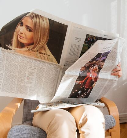 french ethnicity: PARIS, FRANCE - APR 24, 2017: Marine Le pen on newspaper article of Die Zeit - woman reading t newspaper a day after the first round of the French Presidential election on April 24, 2017 Editorial