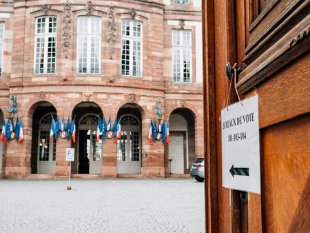 STRASBOURG, FRANCE - MAY 7, 2017: French polling station Bureau de vote sign on door with French flags ready for second round of the French presidential election to choose between Emmanuel Macron and Marine Le Pen