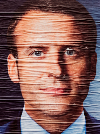 STRASBOURG, FRANCE - MAY 7, 2017: Emmanuel Macron portrait poster detail next to polling place during the second round of the French presidential election to choose between Emmanuel Macron and Marine Le Pen