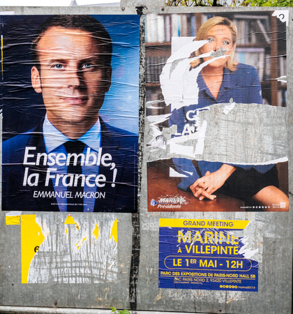 STRASBOURG, FRANCE - MAY 7, 2017: French city with vandalized Le pen poster newar poling place during the second round of the French presidential election to choose between Emmanuel Macron and Marine Le Pen