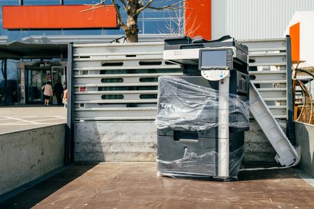 xerox: Technology transportation - Modern multifunction copy machine in van trunk during office moving - office equipment transportation