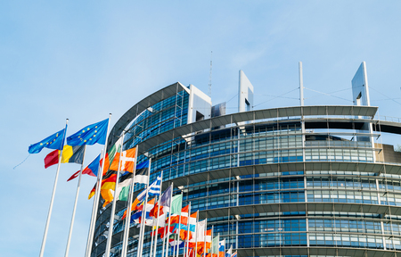 The European Parliament building in Strasbourg, France with flags waving calmly celebrating peace of the Europe Stock Photo