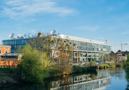 newsroom: STRASBOURG, FRANCE - Apr 12, 2017: Arte (Association Relative a la Television Europeenne) television headquarter in Strasbourg elevated view with ILL river on a spring morning