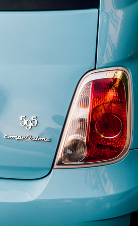 STRASBOURG, FRANCE - MAR 31, 2017: Rear view of Fiat 595 Competizione chrome signage and stop secure light on a sport Fiat car made by the Abarth ateliers in Italy Editorial