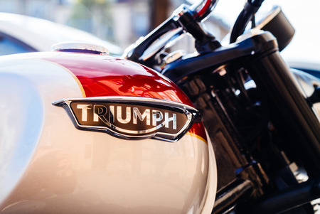 STRASBOURG, FRANCE - APR 3, 2017: Triumph Motorcycles logotype on a parked bike on city street. Triumph is the largest British motorcycle manufacturer; it was established in 1984 by John Bloor after the original company Triumph Engineering went into recei Editorial