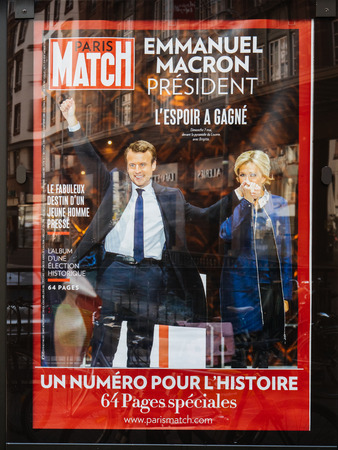 emmanuel: STRASBOURG, FRANCE - MAY 15, 2017: French city press kiosk with Paris Match magazine with Emmanuel Macron and his wife Brigitte Trogneux during handover ceremony presidential inauguration of the newly elected French President Emmanuel Macron in Paris, Fra